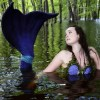 Mermaid swims the St. Croix to share the wonders of water
