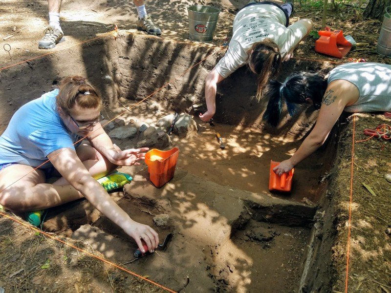 Field school students excavate an archaeological site along the St. Croix River in 2017.