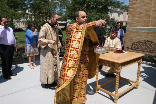 Father George blesses the opening of the St. Demetrios meditation garden, Sunday July 17, 2016.