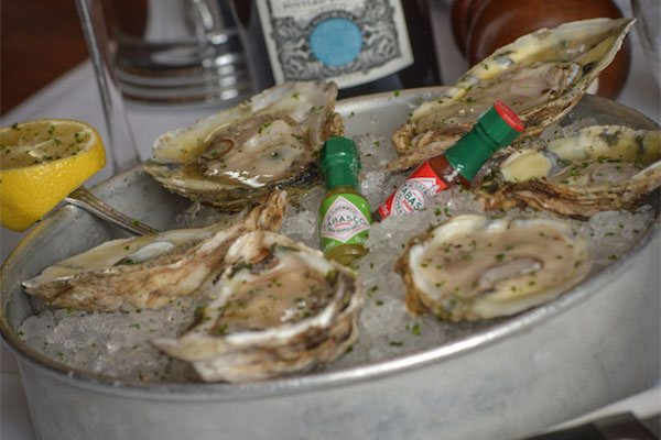 Raw Oysters in an Ice Bucket