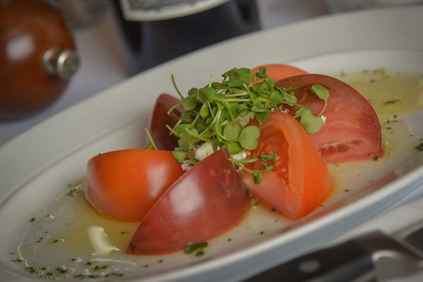 Tomato Salad topped with herb seasoning