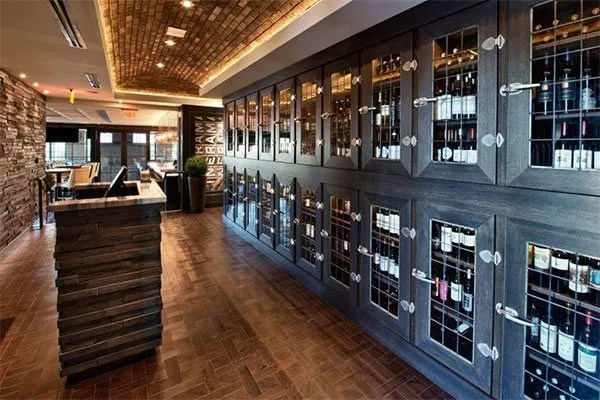 The wine vault features cabinets which house the wine