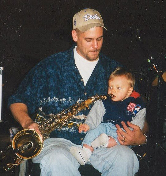 Sam Stebnitz trying out the sax for the first time at Dad's final performance with his band, End of the Line