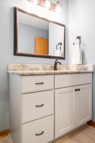 Shaker Style Painted Maple Vanity with granite counter top.