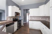 White Paint Transforms These Golden Oak Cabinets