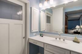 New vanity with a solid surface counter top and a Delta chrome faucet.