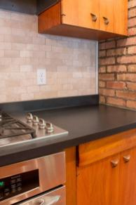 Beige stone tile backsplash