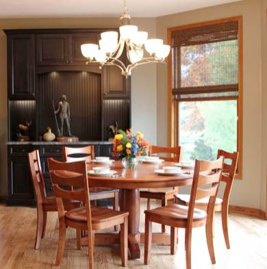 Dining area is open to the kitchen and great room with oak floors throughout.