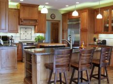 Large Island with Granite top provides extra seating