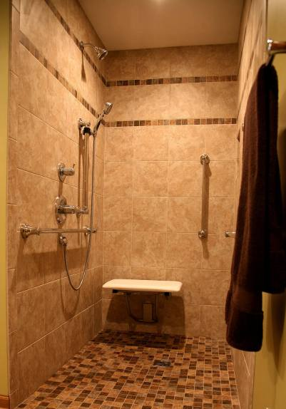 Shower gets a makeover to make it wheelchair accessible.