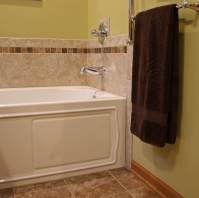 Kohler apron front soaking tub.