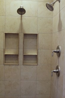 Ceramic tile shower with double shower niches and shower heads