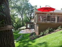 Timber Tech deck and stamped concrete patio add outdoor living space to this property.