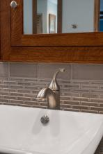 Double vanity includes two vessel sinks with brushed nickel faucets.
