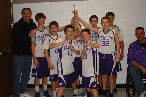 Sam (#32) and his team are proud to be champs!