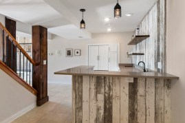 Kitchenette area with reclaimed barn wood detail