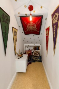 Space under the stairs in transformed into a reading nook perfect for these Harry Potter fans.