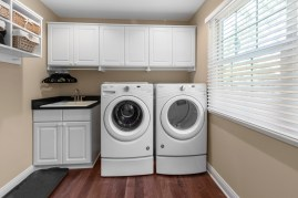 Ample cabinetry make organization easy in this laundry room.