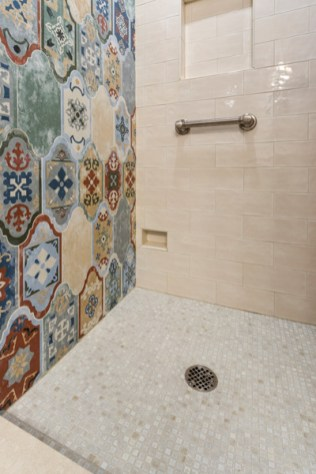 Patterned tile accent wall flows into the shower enclosure.