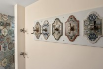 These custom towel hooks were created using extra tile from the accent wall.