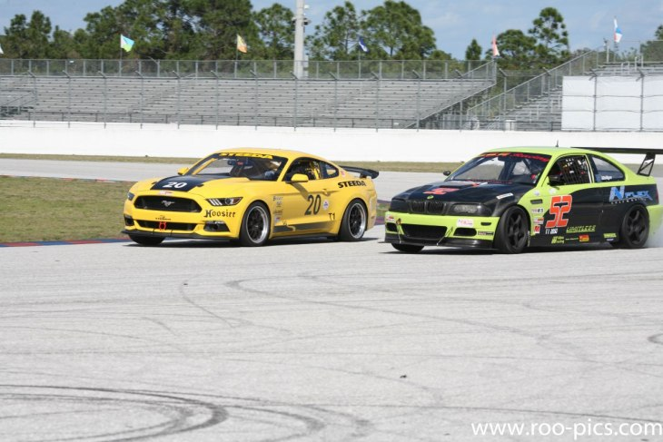 The Steeda Q500R neck and neck with the Number 52 BMW M3.
