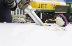fuel nozel filling up jet aircraft