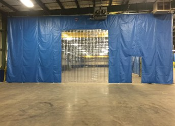 Insulated Curtain Walls with Custom Strip Door Inserts Allow Forklift Traffic through Temperature Controlled Zones
