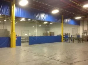 Warehouse curtains divide facilities into spaces to effectively block out noise, dust and contamination in production