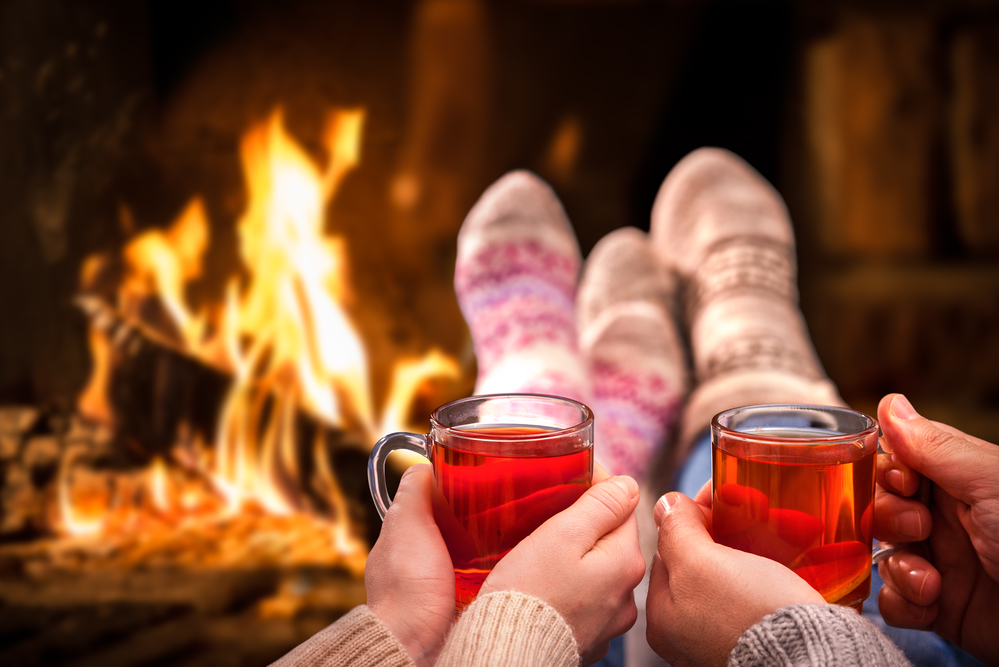 Couple relaxing in front of a fire