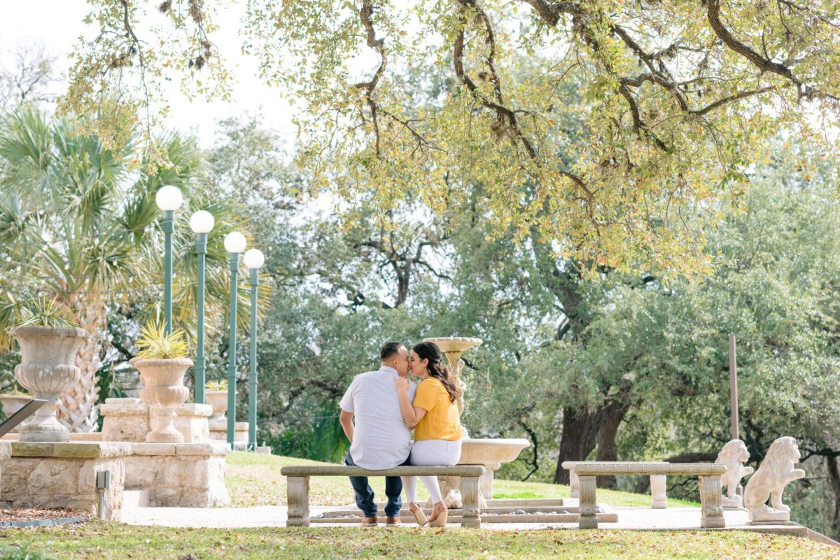 couple romantically nuzzles into each other in private garden at laguna gloria in austin texas