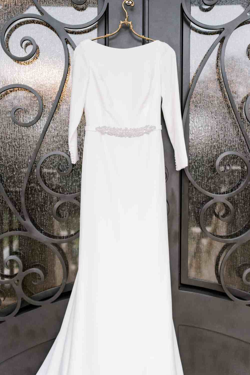 Werdding Dress hanging on Antique Wedding Hanger