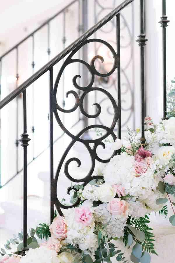 staircase garland at Thistlewood manor & gardens wedding