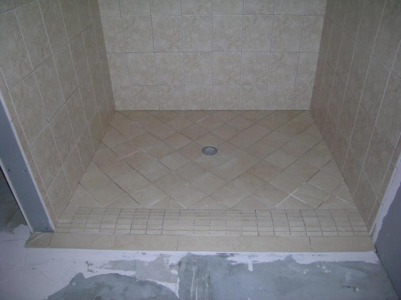 Stephenson Tile Co    Naples Curbless Handicap Accessible Shower Rollover curb shower  Form of a Curbless Shower
