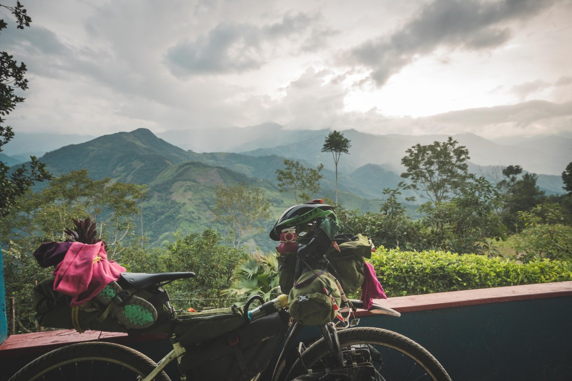 bkepacking backroads of Colombia, a bike with a view of high mountains and clouds.