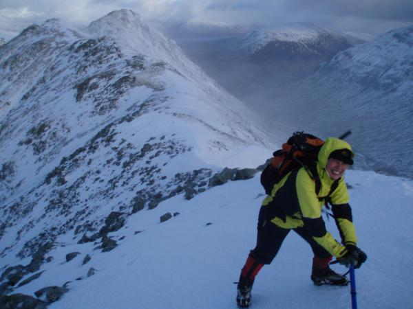 anna-bracing-against-the-wind-on-the-ridge.JPG