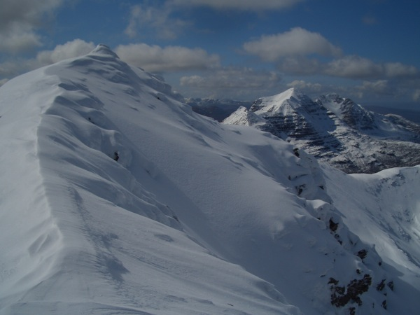 Virgin snow yet to be trodden with Liatach looking on