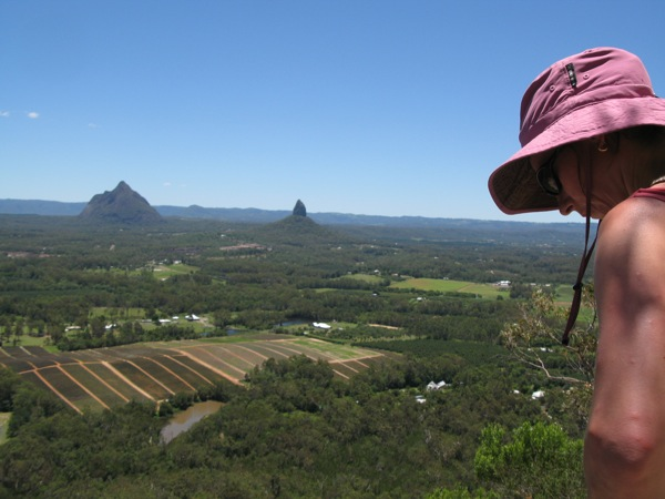 Laetitia contemplating the decent with Beerwah and Coonowrin in the background
