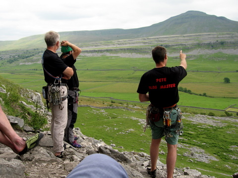 Pete points out the route up Ingleborough