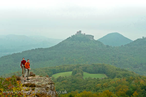 Laetitia and Pete on top of the Asselstein crags with the Trifels castle behind