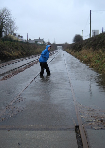 Anna paddles on the railway