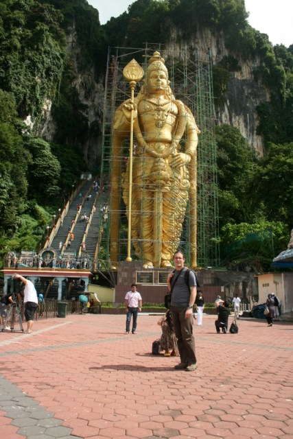 The statue of Murugan and the staircase to the main cave at Batu caves.