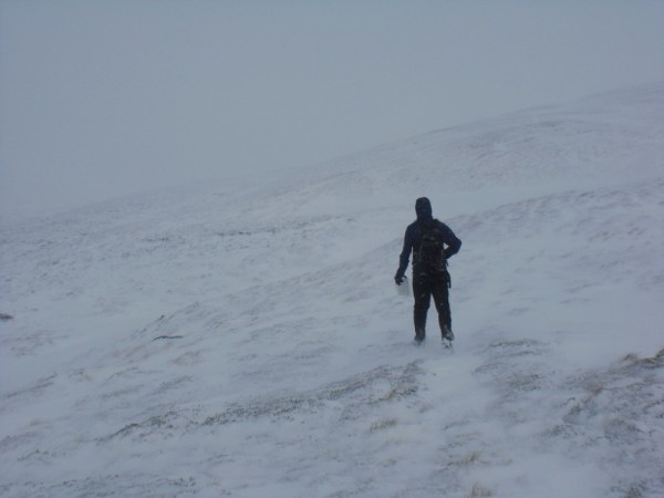 Climbing the hill to the lake. It wasn't this snowy when we started!