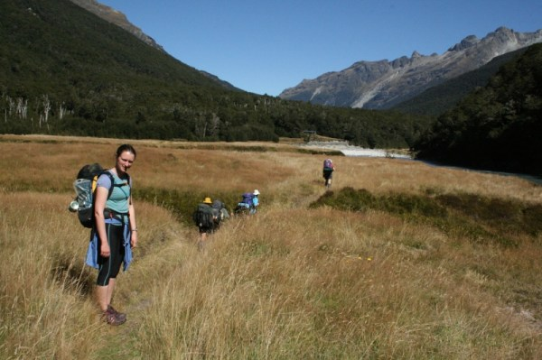 Rachel and the group from the Manawatu Tramping Club crossing the river flats.