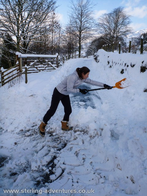 Laetitia digging out the snow ploughed roadside to allow access further up Kentmere