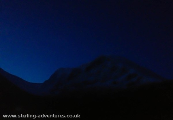Dawn begins to light the sky behind Ben Nevis.