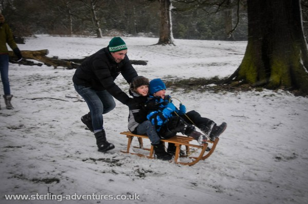 Nick gives James and Oliver a mighty shove down the sledge-run!