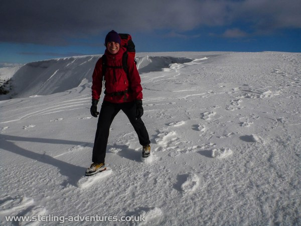 Laetitia having fun on the raised snow footsteps left after recent gales