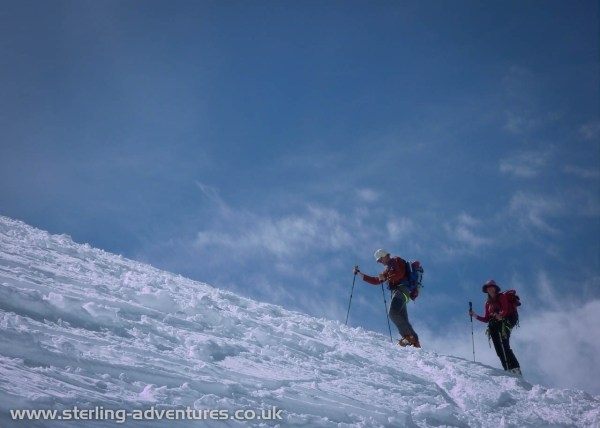 Pete and Laetitia climbing towards the Grands Mulets hut