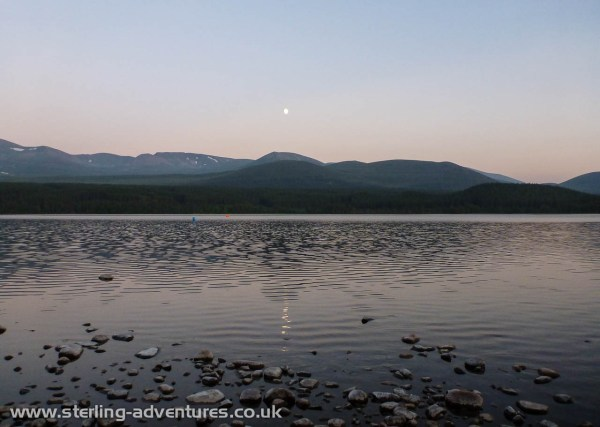 The moon reflected in Loch Morlich, and if you look carefully you can see the clouds of midges coming straight at the photographer - dinner!