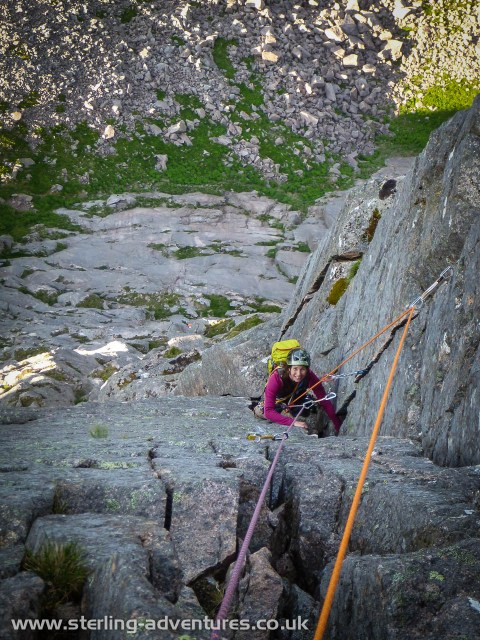 Laetitia looking up the eighth pitch - Needle Crack, the psychological and physical crux!